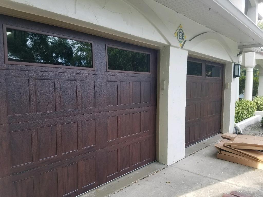 new wood-like garage door with windows